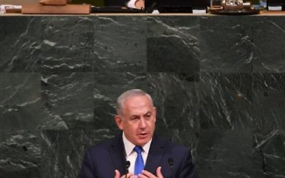 Israeli Prime Minister Benjamin Netanyahu on Sept. 19 addresses the U.N. General Assembly, presided over by Israeli Ambassador Danny Danon. Photo by Shahar Azran