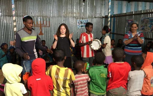 Dalia Hartstein teaches Ethiopian children some Hebrew songs.