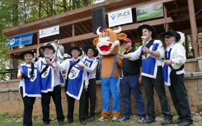 Posing alongside official mascot brisket the bull, the Brisketeers celebrate a third-place finish in brisket at the 2017 Atlanta Kosher BBQ Festival. (Photo by Michael Jacobs)
