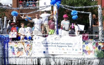 Hand cutouts highlight the Jewish community's float in the Atlanta Pride Parade on Oct. 15.