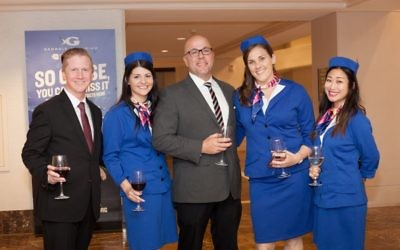 American Hotel staff members dress in 1960s-inspired garb to celebrate the retro renovation Oct. 26