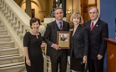 Brendan Murphy (second from left), shown accepting the Georgia Commission on the Holocaust's Educator of the Year award for the second time in May 2016, added the ADL's Abe Goldstein Award to his honors Nov. 2.