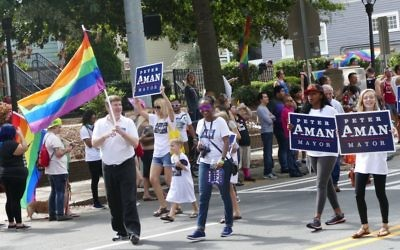 Mayoral candidate Peter Aman and supporters participate in the Atlanta Pride Parade on Sunday, Oct. 15.