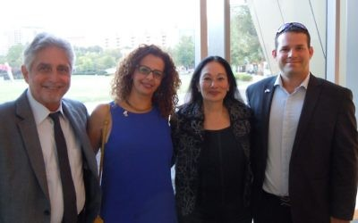 Arnold Heller (left) and Rena Kahn (second from right) welcome Ra'anana representatives Tamar Knimach and Roee Dinovich to Atlanta in September.