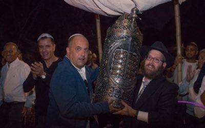 Ron Manoah and Rabbi Mendy Gurary carry the Sephardic Torah.