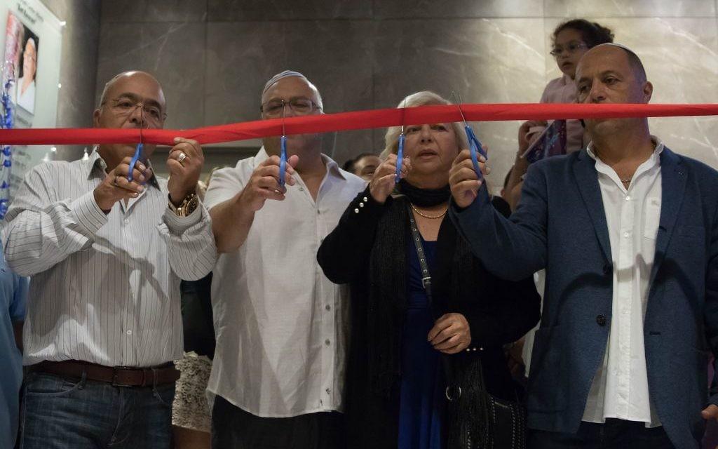 (From left) Ron Manoah, Moshe Manoah, Rivka Manoah and Avi Manoah cut a ribbon marking the grand opening of the Chabad Israeli Center Atlanta. - Photos by Nofar Avigal