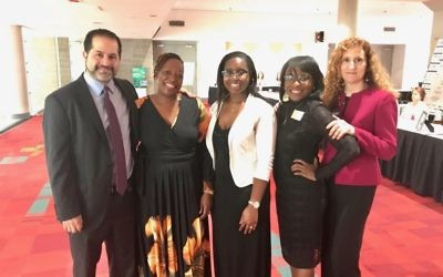 JF&CS Chief Executive Officer Rick Aranson and Chief Program Officer Faye Dresner (right) join MiMi Mondesir (second from left) and her daughters at the Numbers Too Big to Ignore award ceremony.