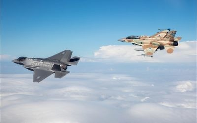 An F-16I Sufa fighter-bomber (right), like the one shot down Saturday, Feb. 10, flies near Israel's first F-35 Adir in December 2016. Lockheed Martin produces both aircraft. (Israeli Air Force photo)