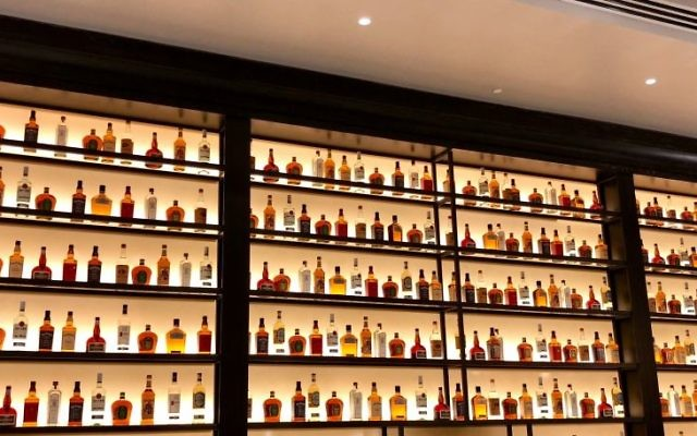 The top-shelf liquor goes on and on at the Courtside Club, open to the 590 people in the first four rows at Hawks games.