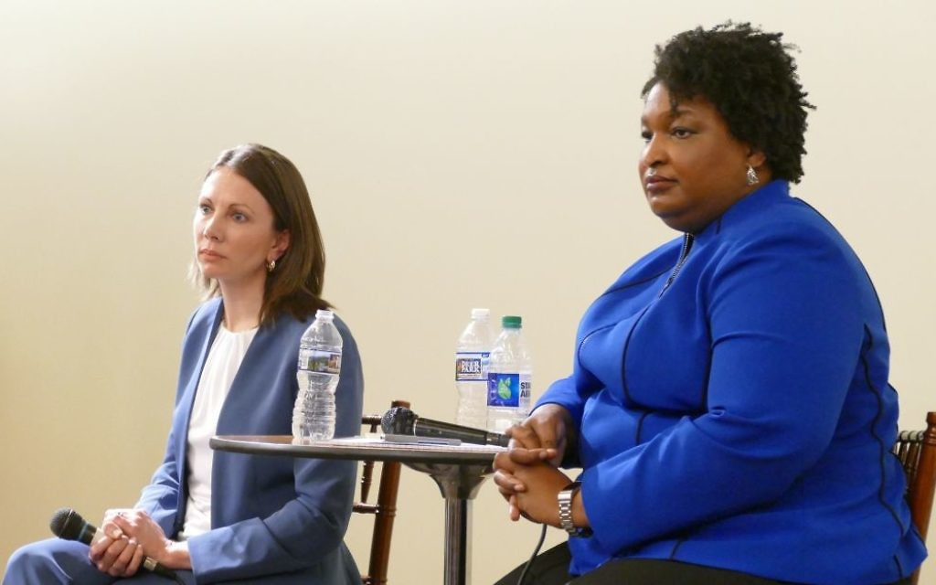Former Reps. Stacey Evans (left) and Stacey Abrams listen to a question from the audience at the Jewish Democratic Women's Salon forum Thursday, Feb. 22, in Sandy Springs.
