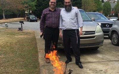 Rabbis Michael Bernstein and Hirshy Minkowicz burn the chametz March 30.
