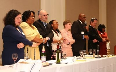 Clergy members at the head table of the 2016 Black-Jewish Seder include Rabbis Ruth Abusch-Magder, Mario Karpuj and Loren Filson Lapidus. Rabbi Lapidus is leading the more diverse Unity Seder this month.