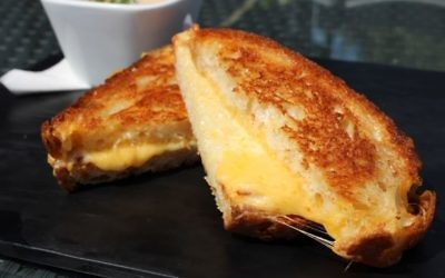 Two kinds of cheese enhance the crispy goodness of the grilled cheese sandwich at Three Sheets.