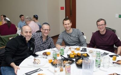 (From left) Edan Shapiro, Joey Wilson, Dave Katzman and Joel Avrunin are ready for the first course at the Man Seder. (Photo by Eli Gray)