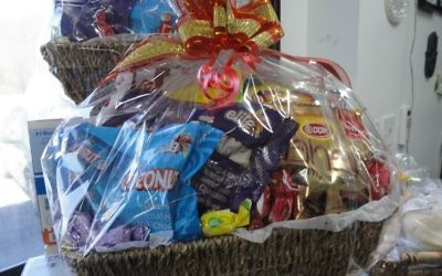 Micka Lewit assembled 60 Passover gift baskets and is confident she'll sell them all.