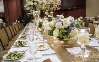 Alyson Pollack arranged each table with intricate details for the wedding reception at the Omni at CNN Center.