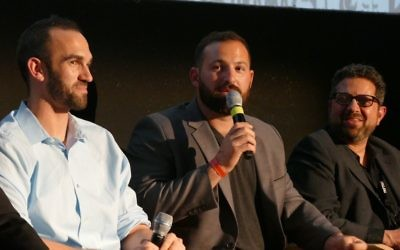 """Cody Decker, who insists that his favorite baseball film is the Tom Selleck classic """"Mr. Baseball,"""" answers a question after the second of three screenings of """"Heading Home"""" at the Atlanta Jewish Film Festival in February. To his right is teammate Josh Zeid; to his left is filmmaker Seth Kramer."""