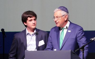 Ziv Zusman (left), the founder of JNF's Sababa Society, listens to Alan Lubel's vow to keep JNF vibrant for generations to come April 19 at the Buckhead Theatre.