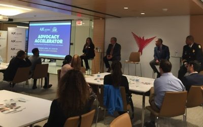 Wellspring Living's Sarah Richardson speaks about human trafficking during the ACCESS/Black-Jewish Coalition's Advocacy Accelerator event April 23, while Bob Rodgers, Judge Eric Richardson and Deputy Chief Vance Williams listen.