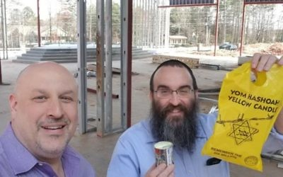 HOD Lodge Shimshon President David Adler delivers Yom HaShoah candles to Chabad of North Fulton Rabbi Hirshy Minkowicz.