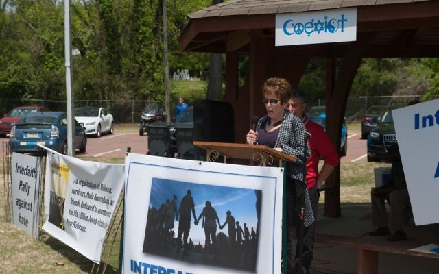 Organizer Nadine Winter opens the Interfaith Rally Against Hate in Newnan's Lynch Park. (Photo by Mark Winter)