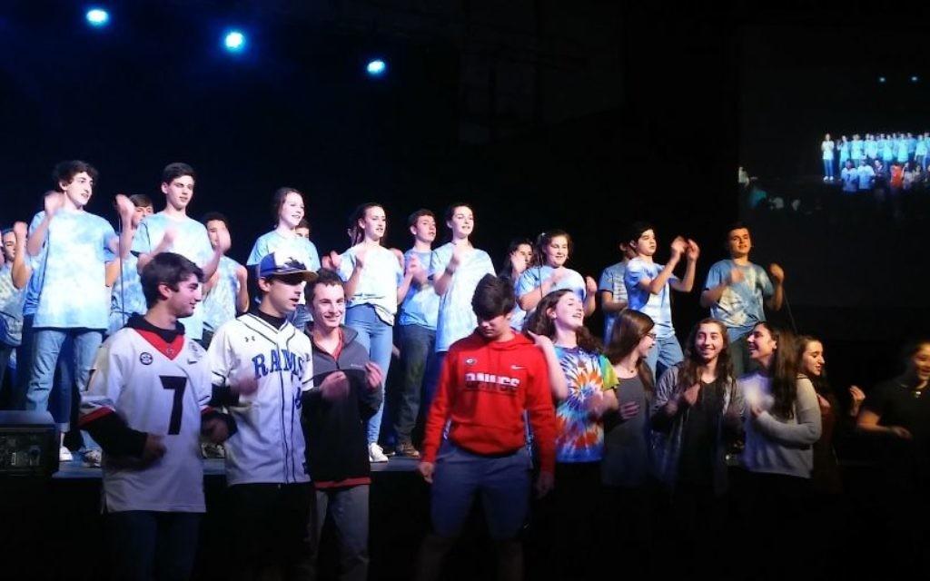 "Epstein alumni join in the ""Shir Israeli"" finale at the Epstein School's ""Shiriyah"" in February."