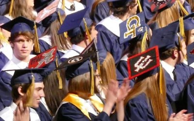 Some Weber grads wear their college plans on their mortarboards.