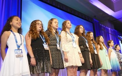 """Epstein School students, including Garry Sobel's saughter, sing """"Hatikvah"""" after singing """"The Star-Spangled Banner"""" to open the FIDF gala."""