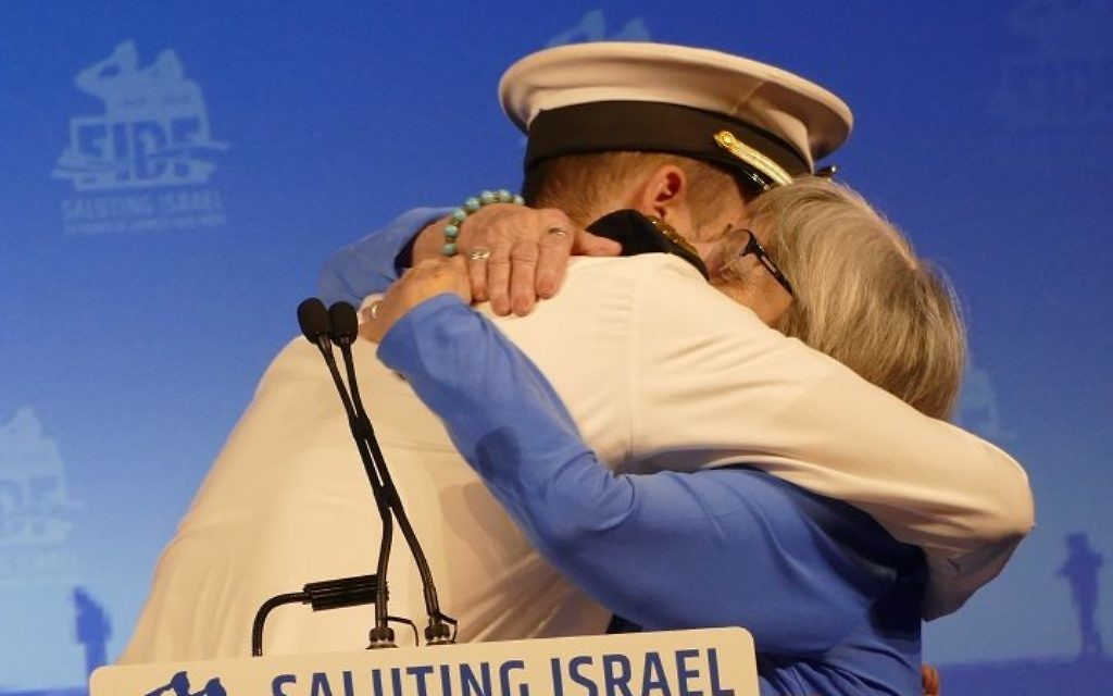 Lt. Y gets a hug from his grandmother Judith, a survivor of the Holocaust from Poland, during the FIDF gala at the InterContinental Buckhead on May 14.