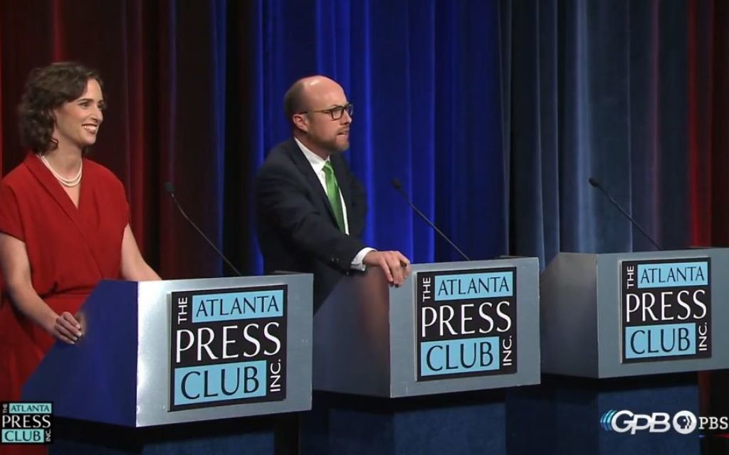 John Noel turns away from Lindy Miller to ask Johnny C. White's empty chair a question during the Atlanta Press Club debate. (YouTube screen grab)