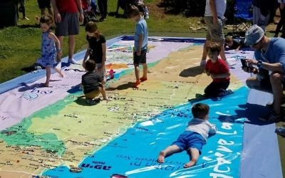 The play-mat map of Israel at the Israel@70 celebration is symbolic of Israel's role to support the Jewish people. (Photo by Kaylene Ladinsky)
