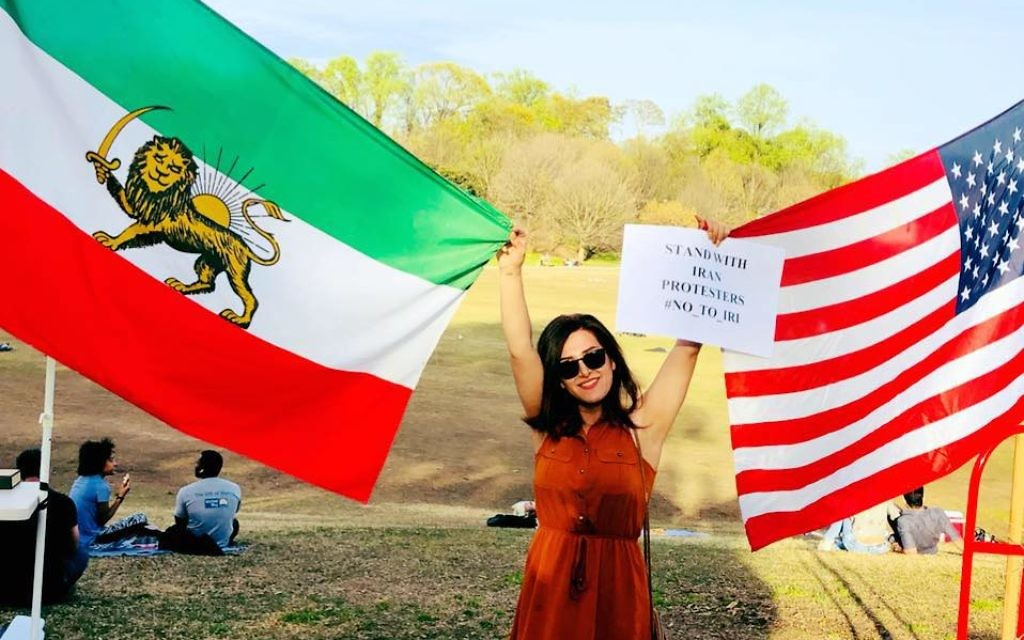 Iranian-American Hengameh Yazdani takes a moment to show her solidarity with America during the Atlanta Persian Festival Sunday, April 1 at Piedmont Park.