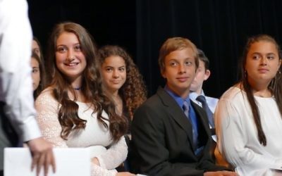 (From left) Devorah Addess, Shayna Leibowitz, Josh Alhadeff and Mikayla Avdar-Rubin watch as Binny Frenkel returns to his seat after receiving his certificate.