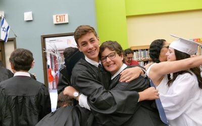 Alon Rogow and Nate Artzi share a post-graduation hug.