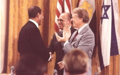 Anwar Sadat, Menachem Begin and Jimmy Carter attend the signing of the Camp David Accords on Sept. 17, 1978, at the White House.