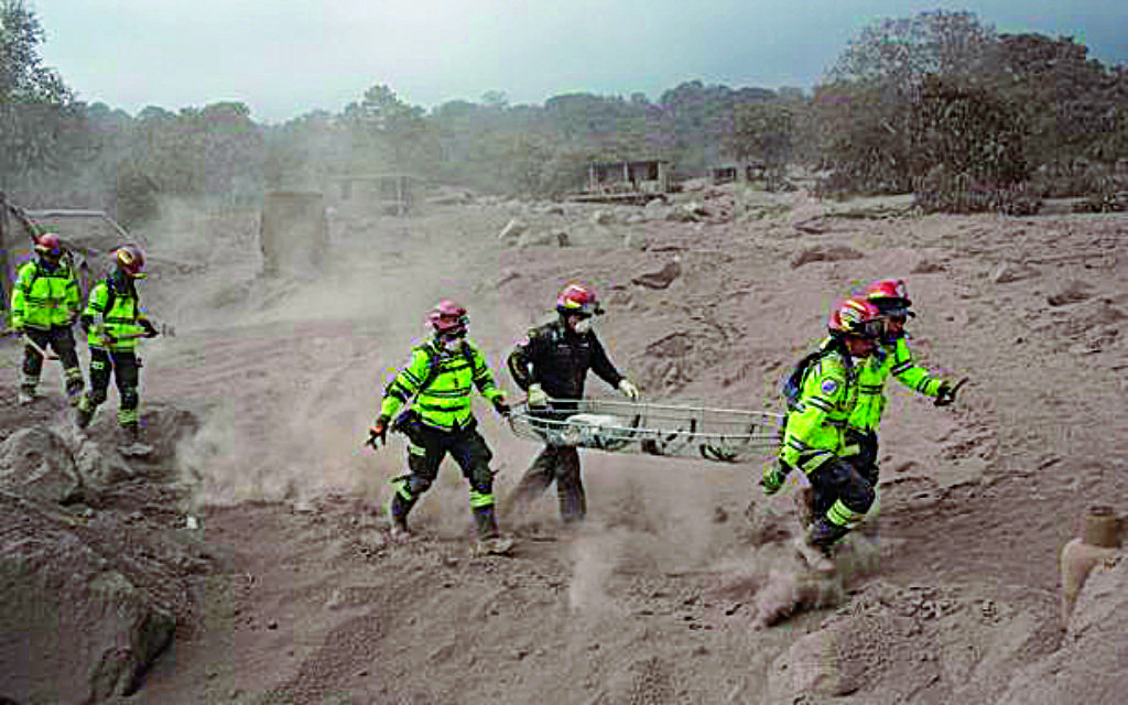 Rescuers rush to provide aid to victims after a volcano erupts in Guatemala.