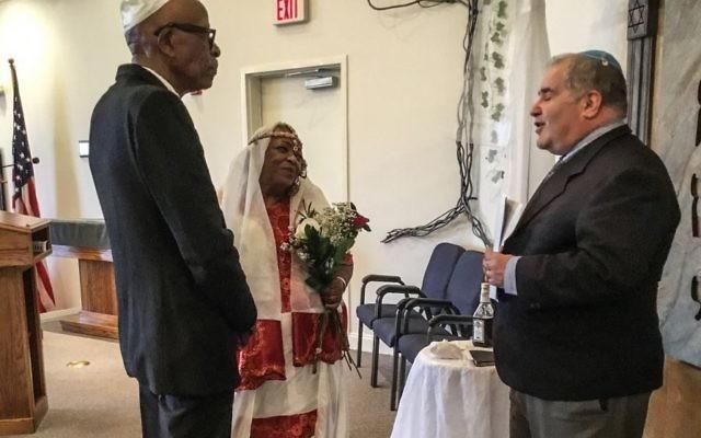 Rabbi Richard Baroff performs the wedding ceremony for Jim Bradford and Beatrice Yehudah on March 12.