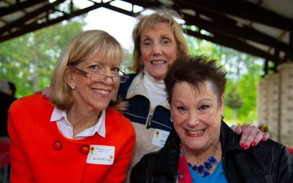 (From left) Liz Becker Lee, Mary Jane Becker and Reva Shapiro volunteer at the registration table.