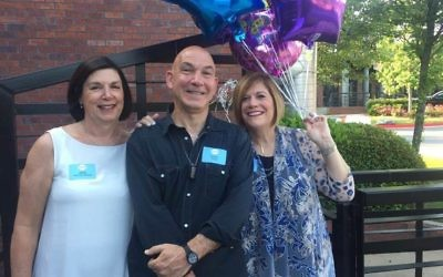 Beth Weiller Arogeti, Doug Teper and Susan Gordon Moray prepare to welcome guests for the 60th Jewbilee.