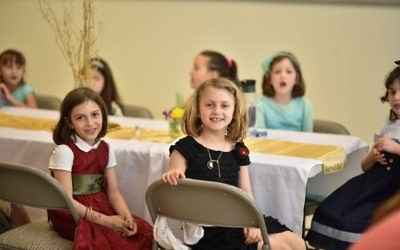 AJA first-graders, who planned the wedding lunch, also get to enjoy it.