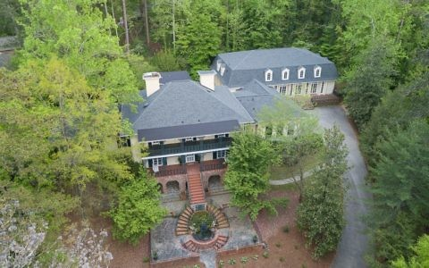 Photos courtesy of Dorsey Alston Realtors The Dubrof family home, including the indoor pool house addition.
