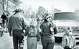 Photos by Eugen Schoenfeld. FAMILY AT FLEA MARKET, 1975 Atlanta