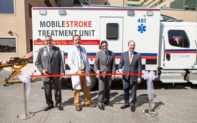 Cutting the ribbon for the new Grady mobile stroke unit was (from left): John Haupert, of Grady Health System; Michael Frankel, Marcus Stroke Network and Vascular Neurology at Emory School of Medicine; Bruce Inverso, American Heart Association; and Jonathan S. Lewin, Emory University health affairs and Woodruff Health Sciences Center.
