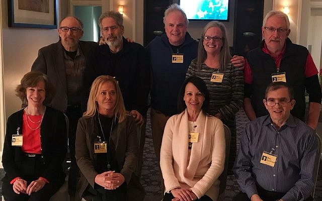 A re-creation of the old Gottfried siblings photo showing descendants of the survivors. Front (from left): Judy Gottfried, Jennifer Thaw, Lisa Gottfried Feiner, Bob Gottfried. Back (from left): Jeffry Gottfried, Gary Shapiro, Bill Turcotte, Meg Thomson, Mauricio Smid.