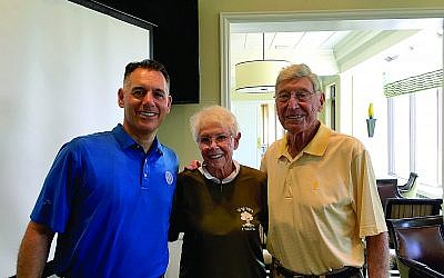 Glen Golish, board chairman of Helping Israel Fund, Inc., (left) poses with corporate sponsors, Billi and Bernie Marcus.