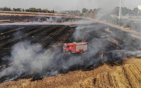 An Israeli fire truck tries to douse a devastating fire in Eshkol, Israel, caused by flaming kites.
