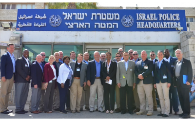 The Southeast delegation pose in front of the Israel Police Headquarters