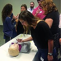Georgia Hillel staff practice administering Narcan, the drug used to reverse an opioid overdose.