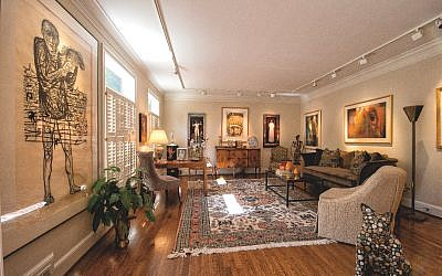 "Formal living room, from left: ""Man of Peace"" woodcut by Leonard Baskin interpreted at his distaste for Picasso's hypocrisy. Center rear wall from left: ""The Juggler"" by David Kidd, ""Chief Crazy Horse"" by Baskin. Far right over couch: ""The Ballet Dancer"" by Lee Bomhoff. (Photo by Duane Stork)"