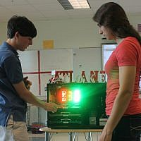 Students Justin Cobb and Becky Arbiv learn technology for safecracking.